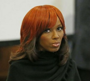 Natasha Stewart, also known as Pebbelz Da Model, looks around the Hinds County courtroom while waiting for her attorneys during jury selection in county court in Jackson, Miss., Monday, Jan. 27, 2014. Stewart is charged with depraved-heart murder in the death of 37-year-old Karima Gordon, of Atlanta. She allegedly helped arrange the unlicensed buttocks injections that prosecutors say killed Gordon in 2012. (AP Photo/Rogelio V. Solis)