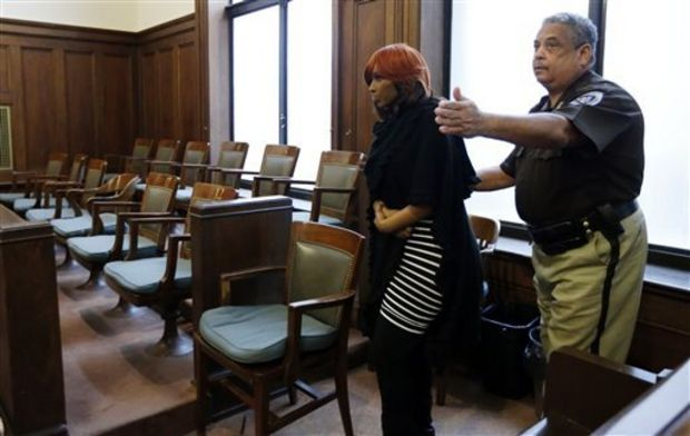 Natasha Stewart, also known as Pebbelz Da Model, is shown her seat by a Hinds County bailiff before jury selection in county court, Monday, Jan. 27, 2014, in Jackson, Miss. Stewart is charged with depraved-heart murder in the death of 37-year-old Karima Gordon, of Atlanta. She allegedly helped arrange the unlicensed buttocks injections that prosecutors say killed Gordon in 2012. (AP Photo/Rogelio V. Solis)
