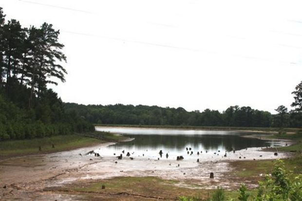 The city of Meridian, Miss., is draining Long Creek Reservoir in Southeast Lauderdale County. City officials said they are draining the lake because they do not have the money needed to repair a leak in the dam. As a result, Long Creek Reservoir will be closing indefinitely or until other sources of funding become available. (AP Photo/The Meridan Star, Michael Stewart)