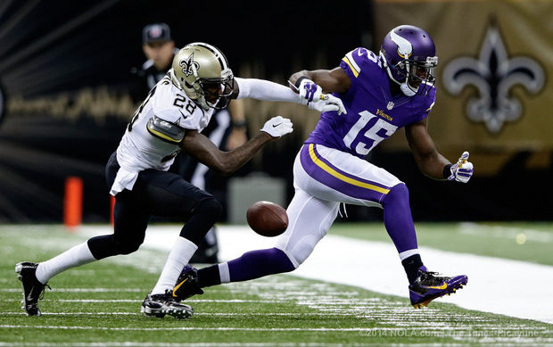 New Orleans Saints cornerback Keenan Lewis (28) breaks up a pass intended for Minnesota Vikings wide receiver Greg Jennings (15) during the game at the Superdome in New Orleans, Sunday, September 21, 2014. (Photo by David Grunfeld, NOLA.com / The Times-Picayune