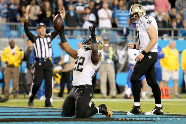 New Orleans Saints running back Mark Ingram (22) and quarterback Drew Brees celebrate after Ingram scores on a second quarter run during the game between the New Orleans Saints and Carolina Panthers at the Bank of America Stadium in Charlotte on Thursday, October 30, 2014. (Michael DeMocker, Nola.com / The Times-Picayune)