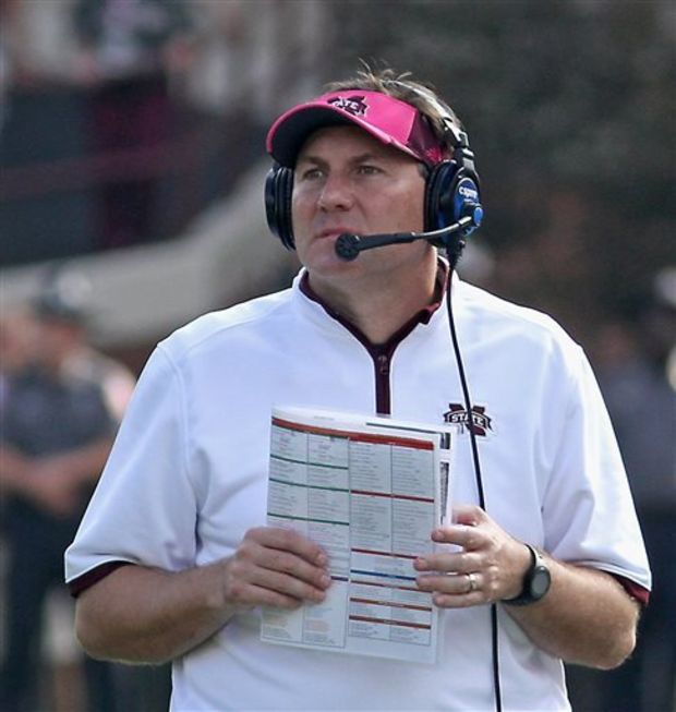 Mississippi State coach Dan Mullen watches a video replay during the first quarter of their NCAA college football game against Auburn in Starkville, Miss., Saturday, Oct. 11, 2014. No. 3 MSU won 38-23 over No. 2 Auburn. (AP Photo/Jim Lytle)