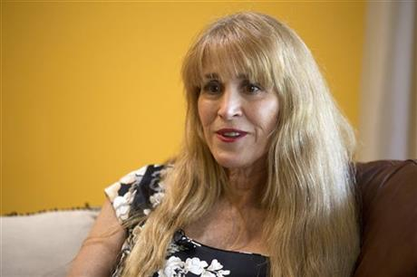 Nurse Therese Serignese, 57, discusses her experience with comedian Bill Cosby at her home on Thursday, Nov. 20, 2014, in Boca Raton, Fla. Serignese said the television icon raped her in 1976 when she was 19 years old following a show in Las Vegas. Cosby spokesman David Brokaw did not respond to a request for comment. (AP Photo/J Pat Carter)