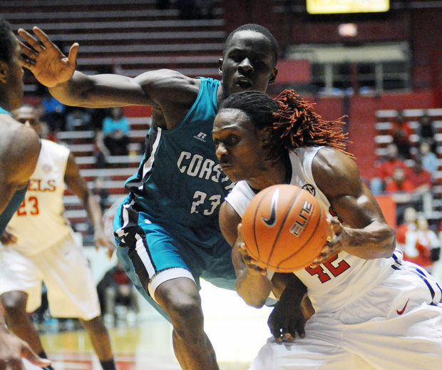 Mississippi guard Stefan Moody (42) dribbles against Coastal Carolina forward Badou Diagne (23) during an NCAA college basketball game, Thursday, Dec. 18, 2014 in Oxford, Miss. (AP Photo/Oxford Eagle, Bruce Newman)