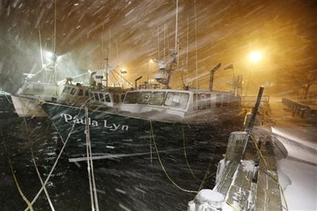 Fishing boats ride out the storm at dock in Scituate, Mass., Tuesday, Jan. 27, 2015. The winter storm packing blizzard conditions spun up the East Coast early Tuesday, pounding parts of coastal New Jersey northward through Maine with high winds and heavy snow. (AP Photo/Michael Dwyer)