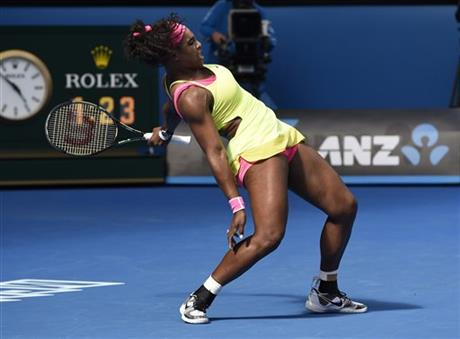 Serena Williams of the U.S. reacts after making a return to her compatriot Madison Keys during their semifinal match at the Australian Open tennis championship in Melbourne, Australia, Thursday, Jan. 29, 2015. (AP Photo/Andy Brownbill)