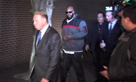 "Death Row Records founder Marion ""Suge"" Knight was arrested early Friday on a murder charge in a fatal hit-and-run."