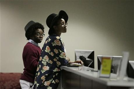 In this Feb. 9, 2015, file photo, Shanté Wolfe, left, and Tori Sisson, right, wait for their marriage license to be processed before becoming the first couple to file their marriage license in Montgomery, Ala. The Alabama Supreme Court on Tuesday, March 3, 2015 ordered the state's probate judges to stop issuing marriage licenses to gay couples, saying previous rulings that gay-marriage bans violate the U.S. Constitution do not preclude them from following state law, which defines marriage as between a man and a woman. (AP Photo/Brynn Anderson, file)