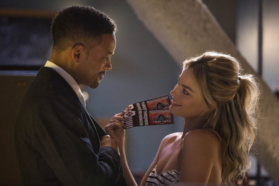 MARGOT ROBBIE and WILL SMITH in a scene from the film Focus. (Warner Bros.)