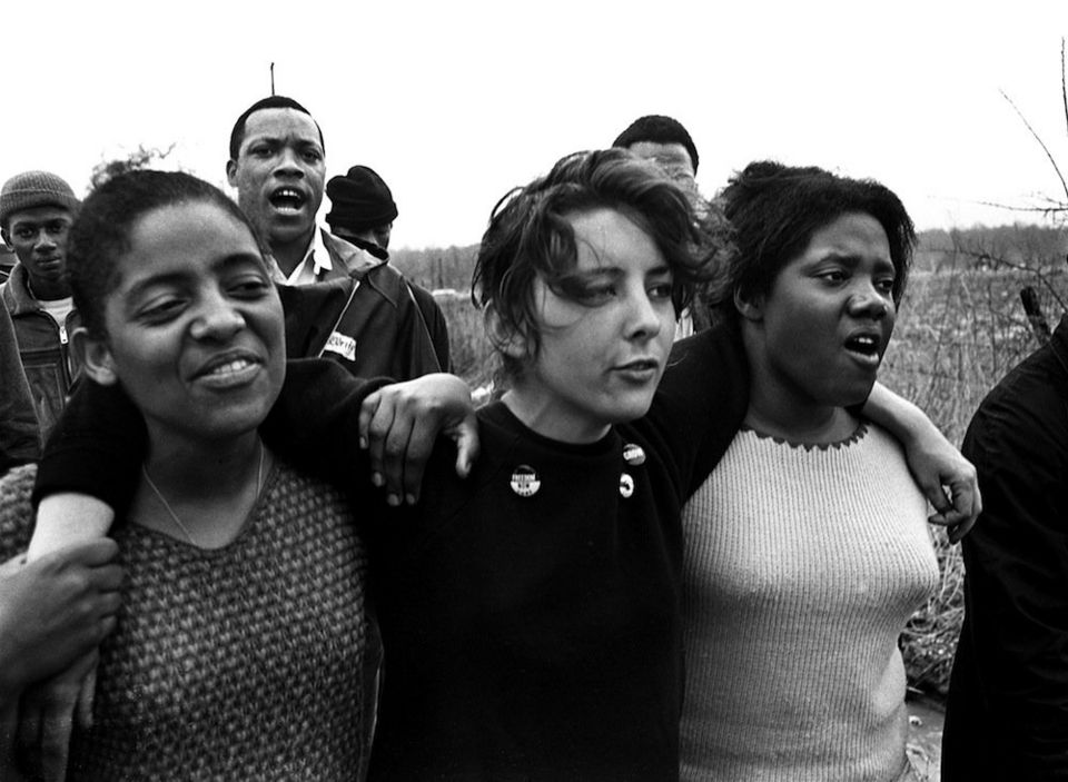 "Young marchers sing freedom songs during the Selma-to-Montgomery march for voting rights in March 1965. (The Birmingham News file/James ""Spider"" Martin)"