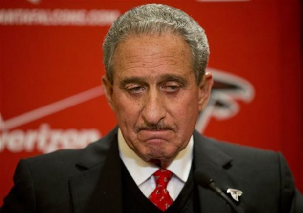 Atlanta Falcons owner Arthur Blank pauses while speaking at a 2014 news conference in Atlanta. The NFL has fined the Falcons, stripped the organization of a draft pick and suspended team president Rich McKay from the league's Competition Committee beginning April 1 following the team's use of fake noise at home games. In statement released Monday, March 30, 2015, the league announced that the Falcons have been fined $350,000 and will forfeit their fifth-round selection in the 2016 draft. If the Falcons have multiple picks in that round, the highest selection will be forfeited. Falcons owner Arthur Blank told The Associated Press in early February that he had seen enough of the NFL's investigation at that point to acknowledge wrongdoing by his club. (AP Photo/David Goldman, File)