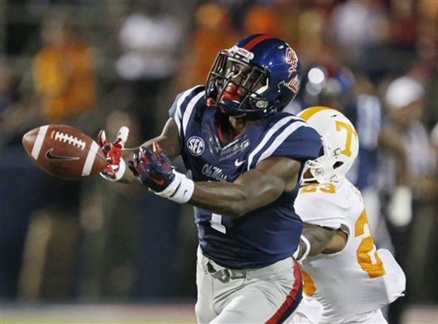 In this Oct. 18, 2014, Ole Miss wide receiver Laquon Treadwell (1) lunges for a pass against Tennessee defensive back Cameron Sutton (23) in Oxford, Miss. Treadwell suffered a season ending broken leg against Auburn last season. He makes his return to the field Saturday when Ole Miss opens the 2015 season against Tennessee Martin. (AP Photo/Rogelio V. Solis, File)
