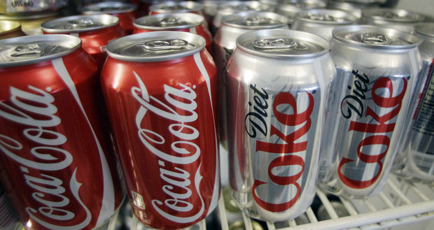 In this March 17, 2011, file photo, cans of Coca-Cola and Diet Coke sit in a cooler in Anne's Deli in Portland, Ore. A nonprofit founded to combat obesity says the $1.5 million it received from Coke has no influence on its work. But emails obtained by The Associated Press show the world's largest beverage maker was instrumental in shaping the Global Energy Balance Network, which is led by a professor at the University of Colorado School of Medicine. Coke helped pick the group's leaders, edited its mission statement and suggested articles and videos for its website. (AP File Photo)