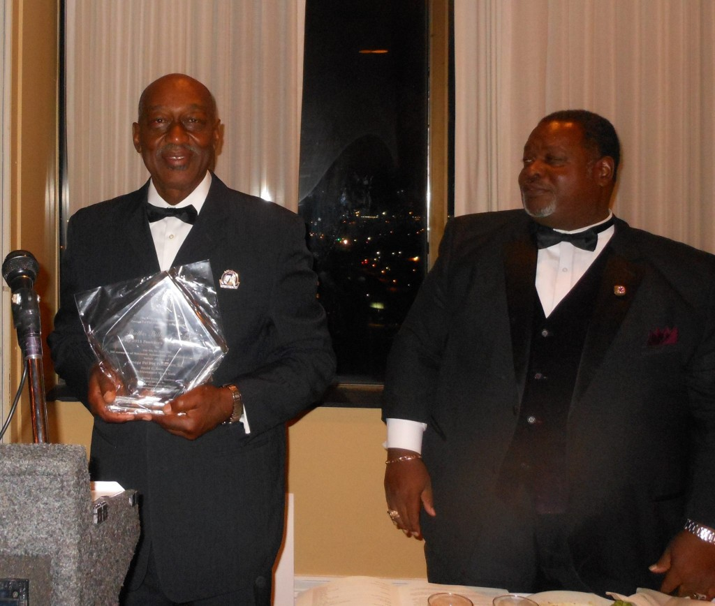 Billy A. Roby accepts the Omega Founder's award. With him is Grand Basileus Antonia Knox Sr. Photos by Stephanie Jones