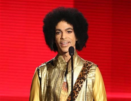 In this Nov. 22, 2015 file photo, Prince presents the award for favorite album - soul/R&B at the American Music Awards in Los Angeles. ABC, NBC, CBS, and CNN, citing unidentified law enforcement sources, reported that prescription painkillers were found on the musician and in his home. The Star Tribune, also citing unnamed sources, reported that prescription pills were found but that it wasn't clear whether they had been prescribed to Prince. Prince was found dead in his Paisley Park home in suburban Minneapolis on April 21, 2016. He was 57. (Photo by Matt Sayles/Invision/AP, File)