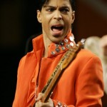 In this Feb. 1, 2007 file photo, Prince plays his guitar during a press conference at the Miami Beach Convention Center in Miami Beach, Fla. Prince