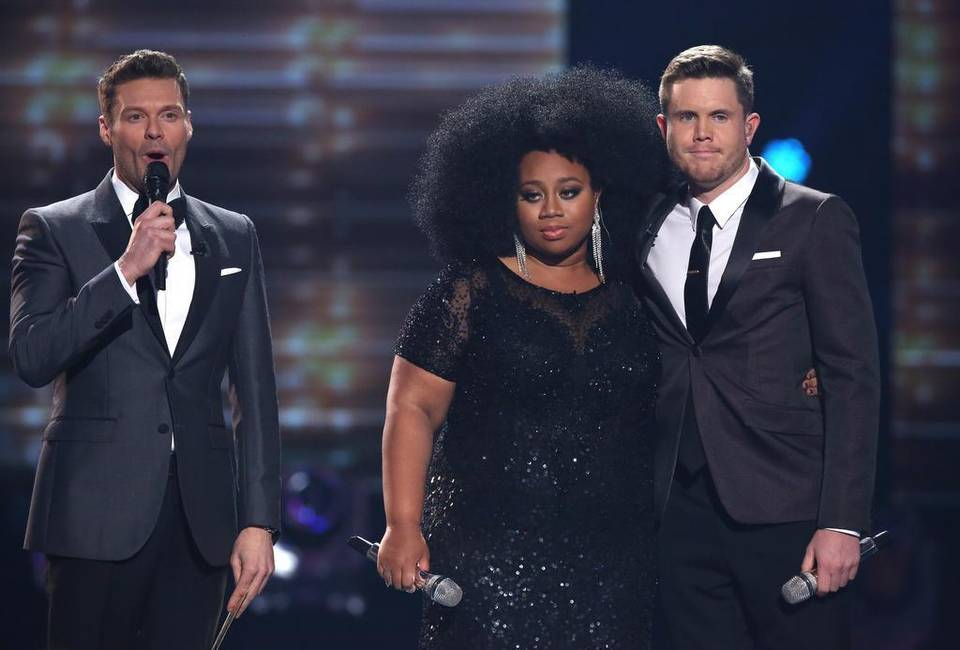 "Ryan Seacrest, from left, La'Porsha Renae, and Trent Harmon onstage at the ""American Idol"" farewell season finale Thursday in Los Angeles. Photo by Matt Sayles/ Associated Press"