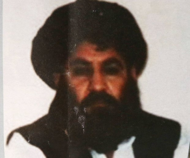 This Saturday, Aug. 1, 2015. file photo shows Taliban leader Mullah Mansour. The U.S. said Saturday, May 21, 2016, that it conducted an airstrike against the Taliban leader, and a U.S. official said Mansour was believed to have been killed. (AP Photo/Rahmat Gul, File)