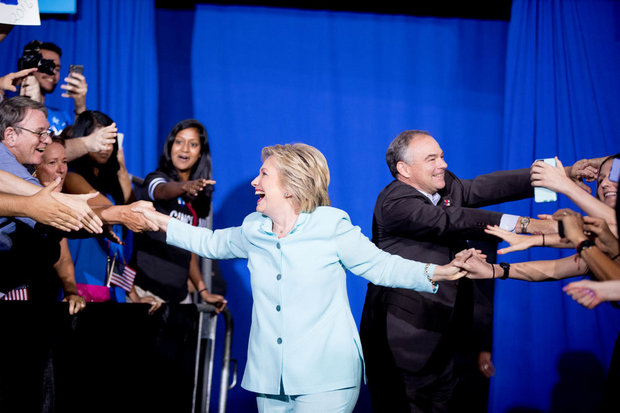 Democratic presidential candidate Hillary Clinton and Sen. Tim Kaine, D-Va., arrive together at a rally at Florida International University Panther Arena in Miami, Saturday, July 23, 2016. Clinton has chosen Kaine to be her running mate. (AP Photo/Andrew Harnik)