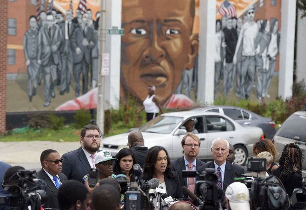 From July 27, 2016: With a mural depicting Freddie Gray in the background, Baltimore State's Attorney Marilyn Mosby, center, speaks during a news conference after her office dropped remaining charges against the three Baltimore police officers who were still awaiting trial in Freddie Gray' death in Baltimore. (Steve Ruark / AP)