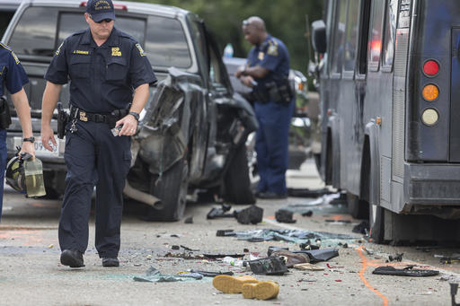 Police investigate the scene of a fatal wreck involving a bus and several cars on Interstate 10 near Laplace, La., Sunday, Aug. 28, 2016. (Chris Granger/NOLA.com)
