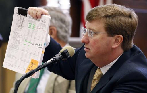 Republican Lt. Gov. Tate Reeves holds a copy of the state Department of Health's submitted budget request for 2018, as he questions State Health Officer Dr. Mary Currier, Tuesday, Aug. 23, 2016, at the Capitol in Jackson, Miss. A select bipartisan grouping of Mississippi legislators, sought to gain additional information regarding expenditures in programs and projects, budget requests, matching funds as review the results in the health care services provided by the Health Department. (Rogelio V. Solis/The Associated Press)