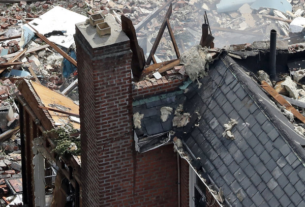 In this Sept. 27, 2016 file photo, debris is seen scattered around at the scene of a house explosion in the Bronx borough of New York. Authorities believe that the house contained an indoor marijuana growing operation and an illegally tapped gas line may have caused the explosion that killed a New York City Fire Department Battalion Chief. (AP Photo/Mary Altaffer, File)