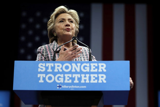 """In this Sept. 30, 2016, photo, Democratic presidential candidate Hillary Clinton speaks during a campaign stop in Fort Pierce, Fla. Clinton told bankers behind closed doors that she favored """"open trade and open borders"""" and said Wall Street executives were best-positioned to help reform the U.S. financial sector, according to transcripts of her private, paid speeches leaked Friday. (AP Photo/Matt Rourke)"""