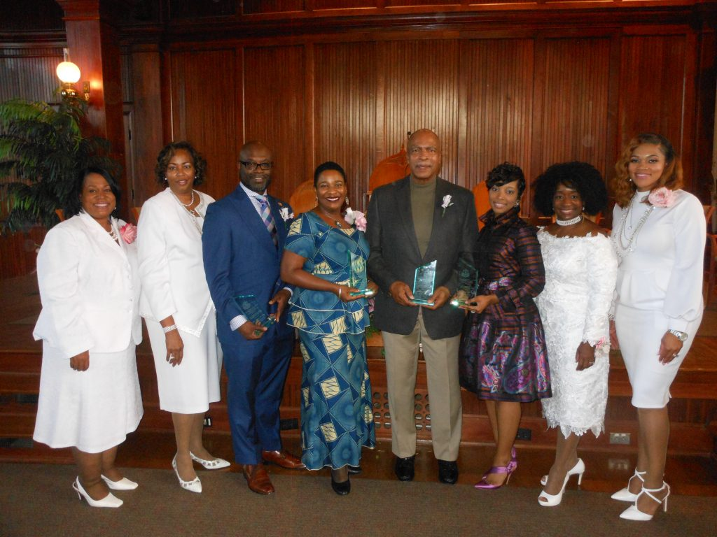 Alpha Kappa Alpha members (in white) present awards to recipients Dr. Byron D. Orey, Dr. Lisa Osunleti, Dr. Larry Johnson and Dr. Scharri Ezell Walker. photo By Stephanie R. Jones