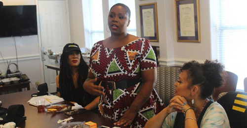 """BLM co-founder Patrisse Cullors (standing) announcing new """"What Matters 2020"""" initiative while in Houston for the Democratic Party debate."""